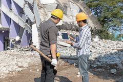 Engineer architect and worker operation control demolish old building.  royalty free stock photography