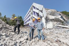 Engineer architect and worker operation control demolish old building.  stock photography