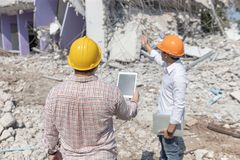 Engineer architect and worker operation control demolish old building.  royalty free stock image