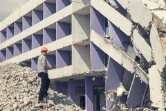 Engineer architect and worker operation control demolish old building. Vintage effect.  stock photo
