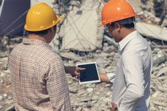 Engineer architect and worker operation control demolish old building. Vintage effect.  royalty free stock photography