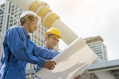 Engineer and Architect working at Construction Site with bluepri Royalty Free Stock Photos