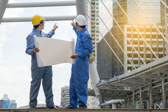 Engineer and Architect working at Construction Site with bluepri Royalty Free Stock Images