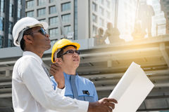 Engineer and Architect working at Construction Site with bluepri Stock Photos