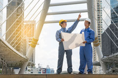 Engineer and Architect working at Construction Site with bluepri Stock Photography
