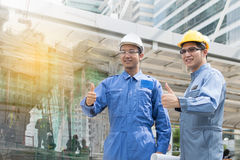 Engineer and Architect working at Construction Site with bluepri Royalty Free Stock Photo
