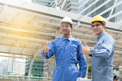 Engineer and Architect working at Construction Site with bluepri Royalty Free Stock Photography