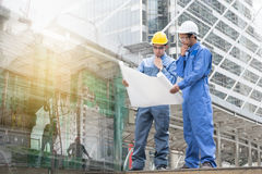 Engineer and Architect working at Construction Site with bluepri. Nt, man Royalty Free Stock Photo