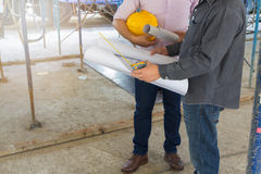 Engineer and Architect working at Construction Site Royalty Free Stock Image