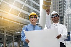 Engineer and Architect working at Construction Site. With blueprint Stock Photography
