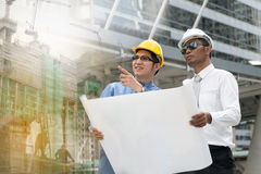 Engineer and Architect working at Construction Site. With blueprint Stock Images
