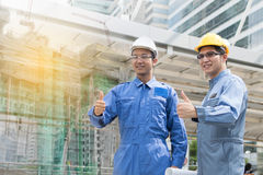 Engineer and Architect working at Construction Site. With blueprint Royalty Free Stock Photos