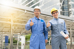 Engineer and Architect working at Construction Site. With blueprint Royalty Free Stock Image