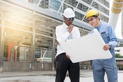 Engineer and Architect working at Construction Site Royalty Free Stock Images