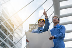 Engineer and Architect working at Construction Site. With blueprint Royalty Free Stock Photography