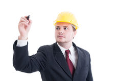 Engineer or architect writing with marker on blank copy space Royalty Free Stock Photo