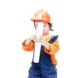 Engineer baby girl and paper in hand Royalty Free Stock Photos