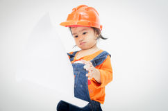 Engineer baby girl and paper in hand Stock Photography