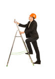 Engineer on Black Suit Posing at Portable Ladder Stock Photos