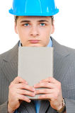 An engineer with blue hard hat holding book Royalty Free Stock Images