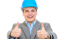 An engineer with blue hard hat thumbs up Stock Photo