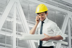 Architect. Engineer with blue prints and cell phone Royalty Free Stock Images