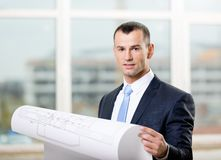Engineer with blueprint. Engineer wearing suit and necktie hands blueprint Royalty Free Stock Photo