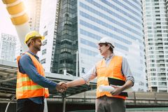 Engineer Boss get handshake, saying thank you to blue collar worker or team for doing work successfully. Employee happy. Blue