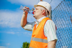 Engineer with bottle of water Royalty Free Stock Photos
