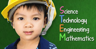 Engineer boy is studying STEM education. On black board Royalty Free Stock Photography