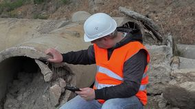 Engineer at the broken concrete pipe stock footage