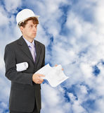 Engineer - builder on background of cloudy sky Stock Image
