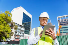 Engineer builder at construction site Stock Photos