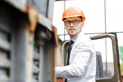 Engineer builder in a helmet holds drawings at  construction site Stock Photo