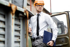 Engineer builder in a helmet holds drawings at  construction site Stock Photos