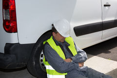 Engineer builder relaxing at construction site, sleeping Royalty Free Stock Photo