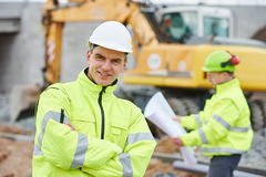 Engineer builders at construction site Royalty Free Stock Images