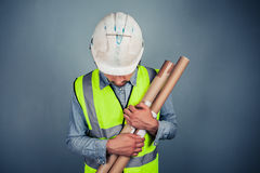 Engineer with building plans Royalty Free Stock Photo
