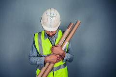 Engineer with building plans Royalty Free Stock Photography