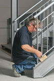 Engineer is building a staircase. An engineer is bolting a galvanized staircase together Stock Images