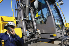Engineer and bulldozer Stock Photos