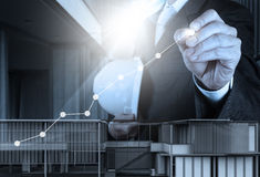 Engineer businessman hand draws business success chart Stock Photos