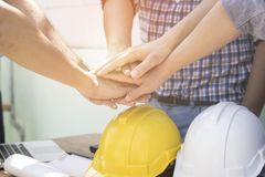 Engineer and businessman take hand coordination. At Construction site Royalty Free Stock Photo