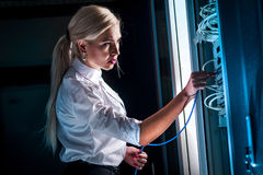 Engineer businesswoman in network server room Royalty Free Stock Image