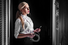 Engineer businesswoman in network server room Royalty Free Stock Photography