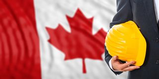 Engineer on a Canada flag background. 3d illustration. Engineer on a waiving Canada flag background. 3d illustration Royalty Free Stock Image