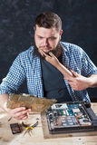 Engineer cant fix problem with computer hardware. Male engineer cant fix problem with computer hardware. Electronic devices repairing technology Stock Photos