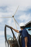 Engineer By Car At Wind Farm Stock Images