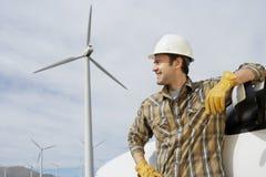 Engineer By Car At Wind Farm Stock Photos