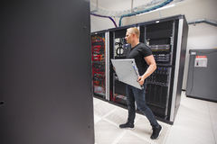 IT Engineer Carrying Blade Server While Walking In Datacenter Stock Images